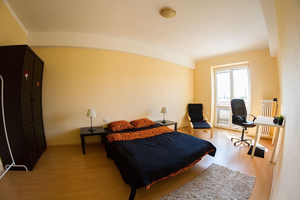 This bedroom has all you need for your comfortable stay in Prague: Comfy bed, wardrobe,  work-table
