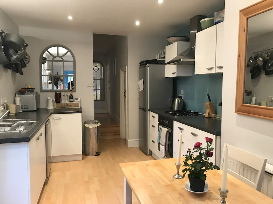 Kitchen with dining table that sears four people, large fridge freezer, gas hob, electric oven, microwave, dishwasher, toaster and kettle