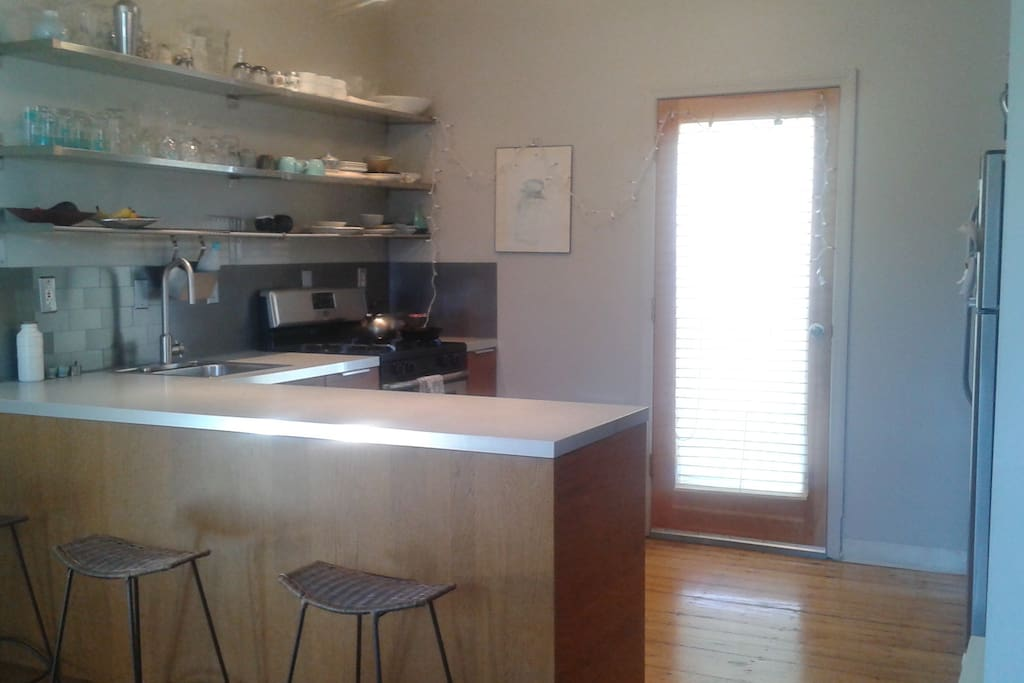 Fully equipped modern kitchen open to living room.