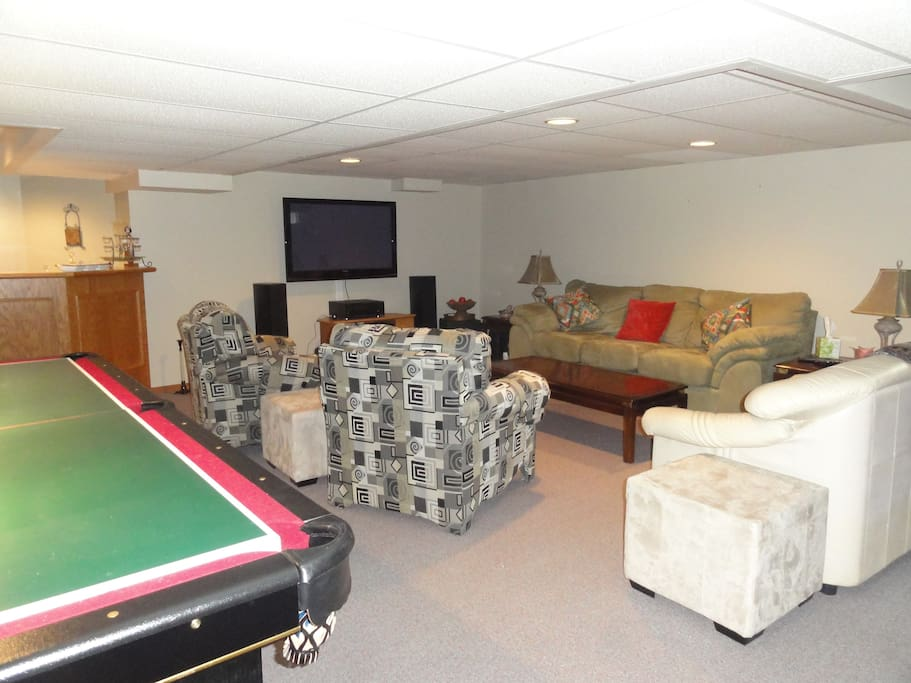 Entertainment Room Features pool table, TV and shuffle board