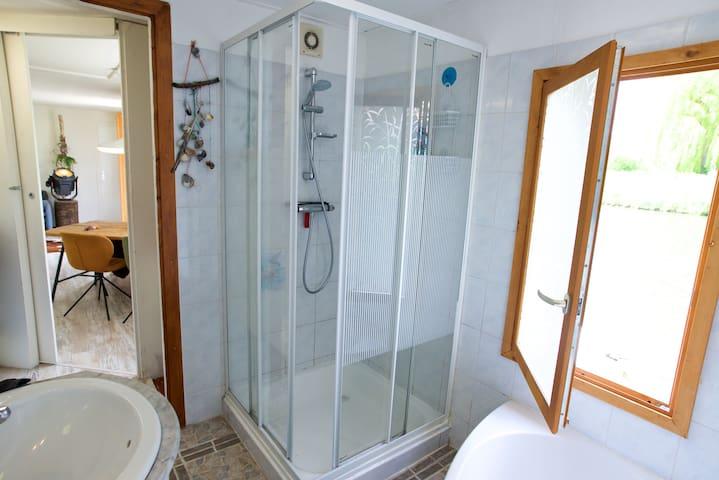 bathroom: shower + bath and toilet