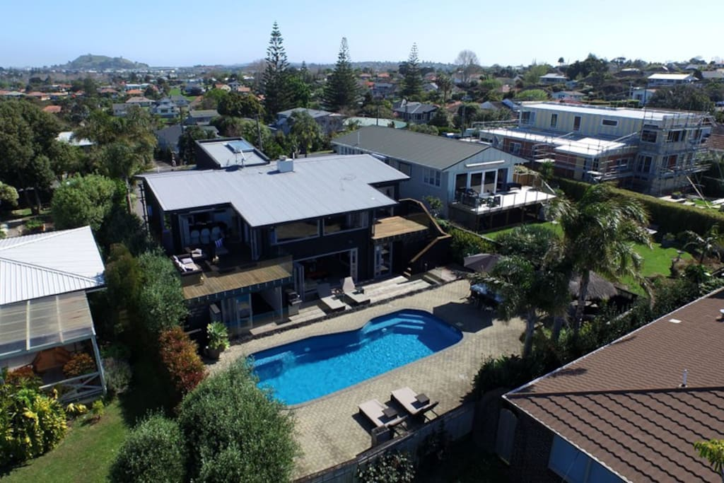 aerial shot of pool side of house