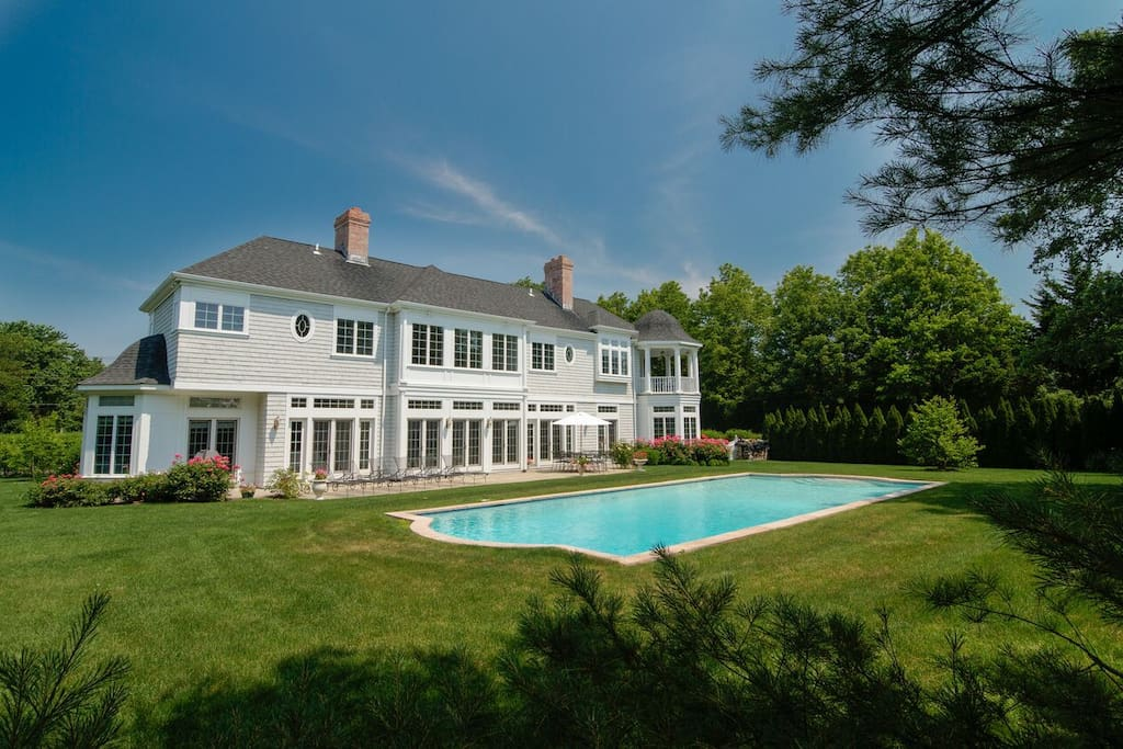 Manicured lawn and gardens affording total privacy.