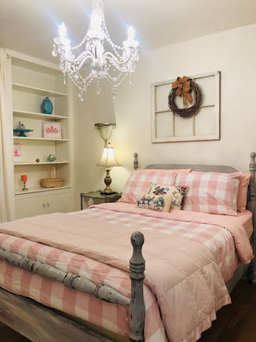Each bedroom designed with love and detail. Here we used a soft, warm color palette with some pink accents for the girl in the family!