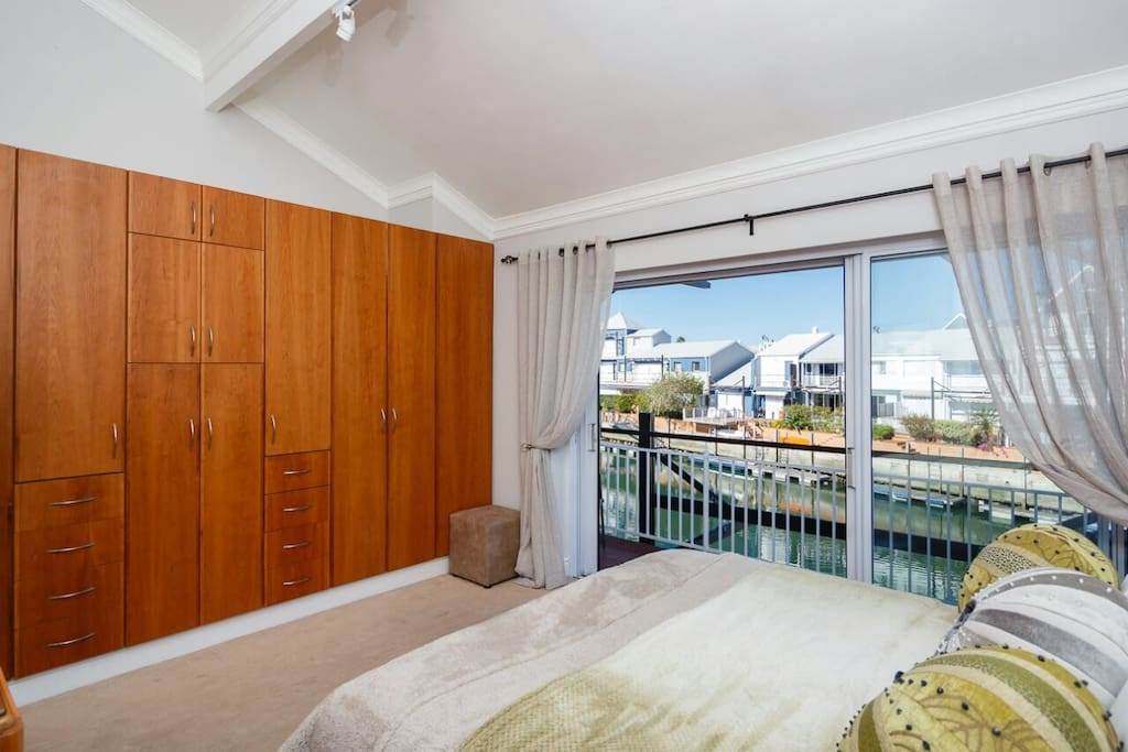 Main bedroom & ensuite with marina views