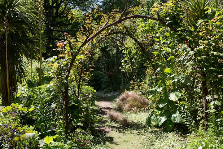 Walkway under a rose arch.