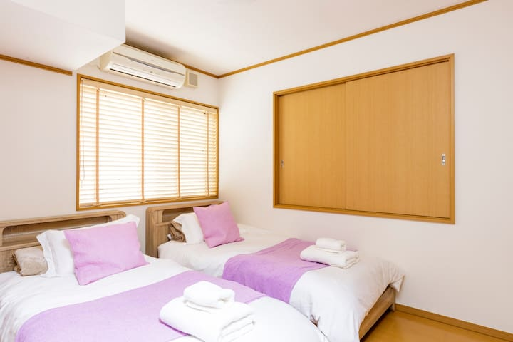 The second bedroom is accented in beautiful lavender amongst the calm neutral tones to ease you to sleep in the night.
