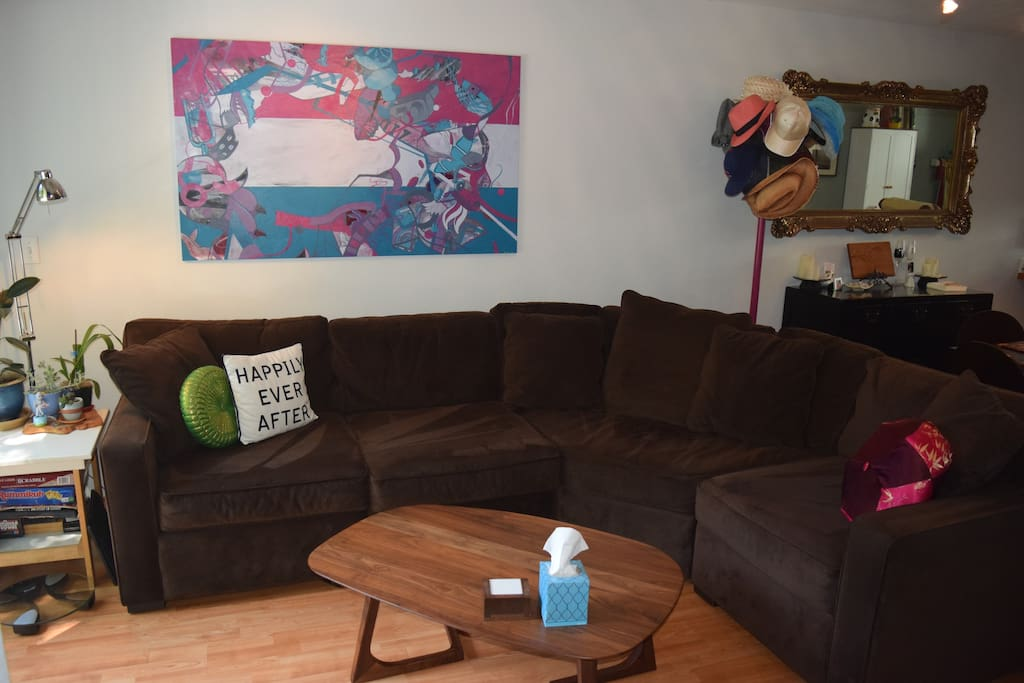Our very cozy couch and local art!