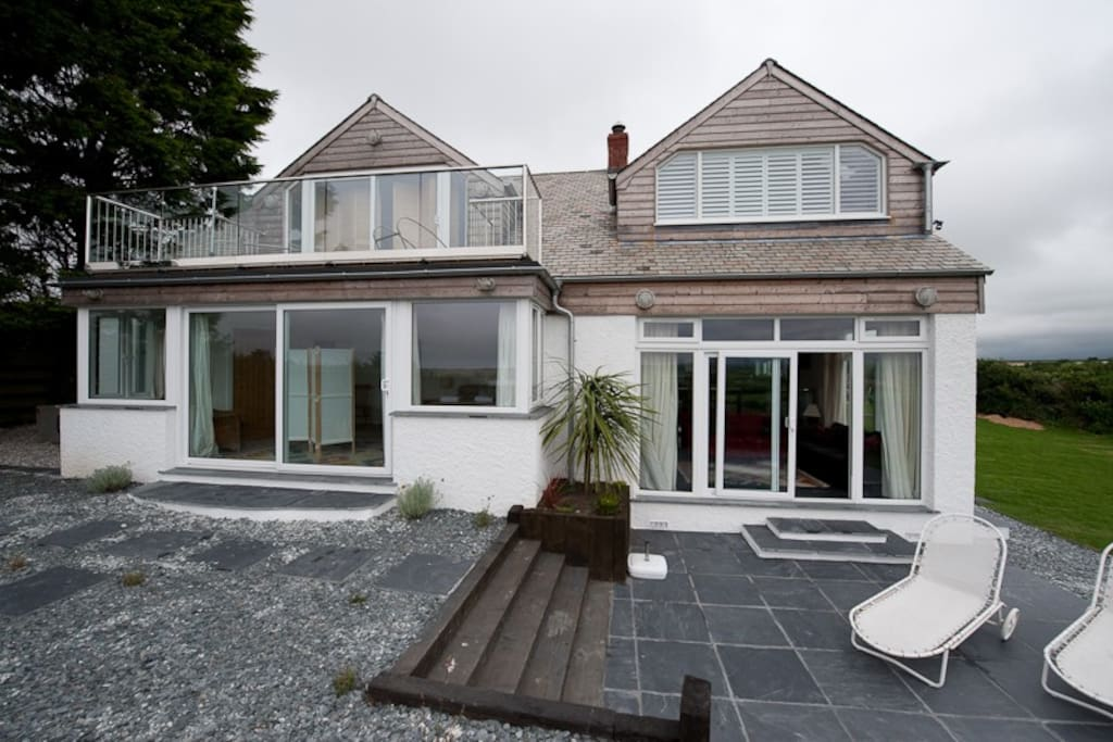 Property with terrace in front.