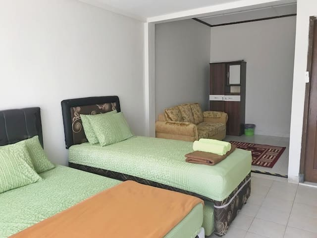 For the convenience of guests, we expand our 2nd bedroom. There are 1 queensize bed & 1 double bed in this room