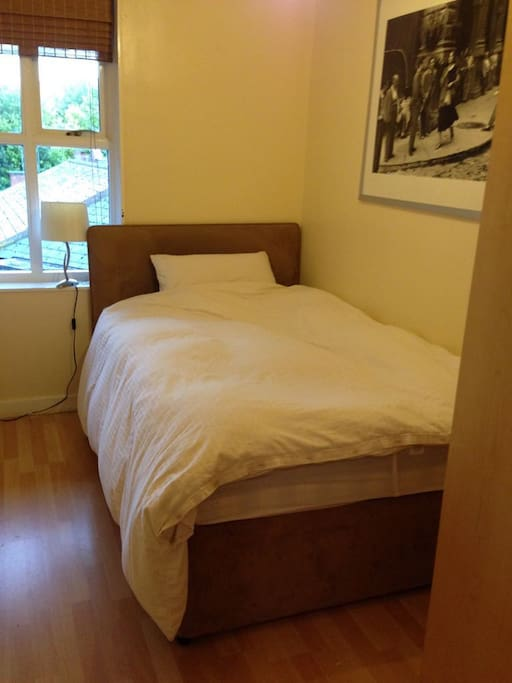 Second bedroom with double bed and wardrobe with plenty of space and hangers for guest clothes