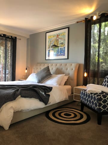 Guest King Bed overlooks Pool and side house. Mirror sliding Wardrobe & Fan