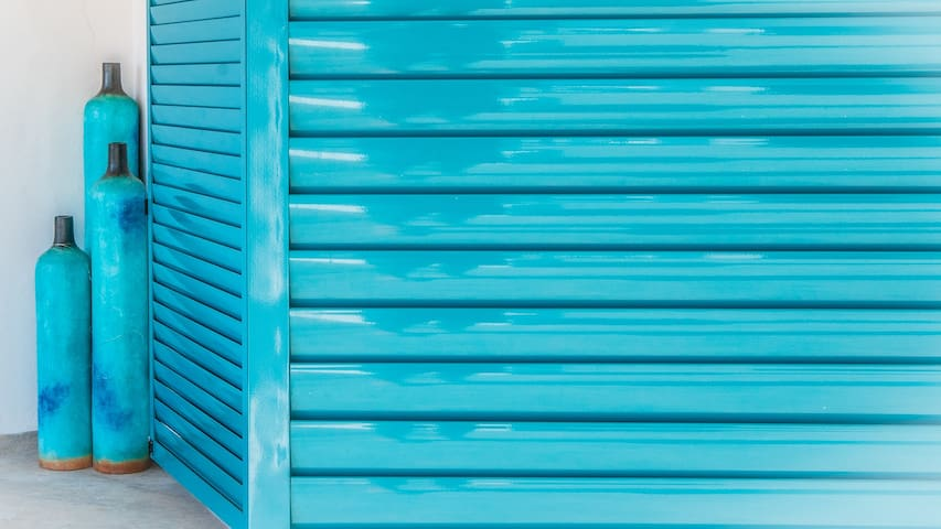 "Specially made anti-hurricane shutters with the owner's favorite color ""Azul""."