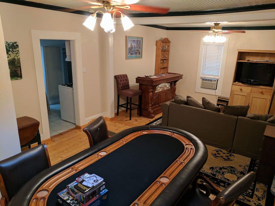 Family room with bar, game table, and sleeper sofa
