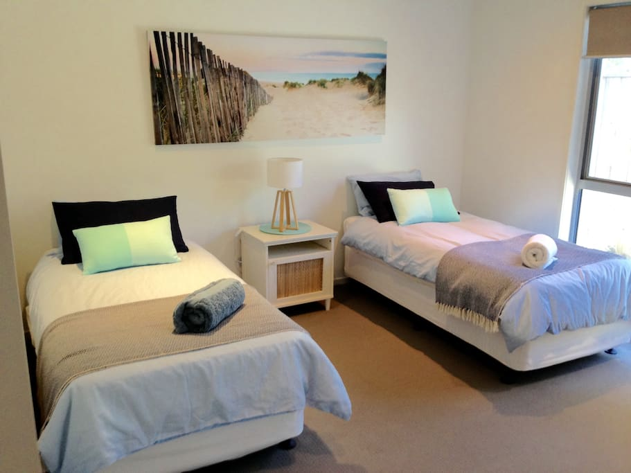 Guest bedroom - can make single beds into one king size bed