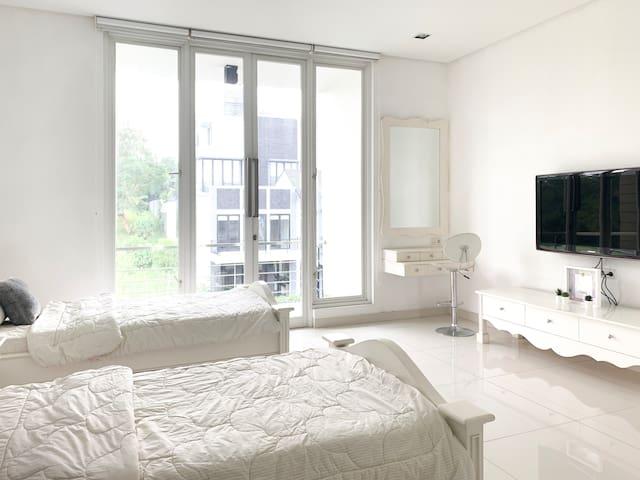 Bedroom 2 (2 Single Beds + 1 Floor Mattress)