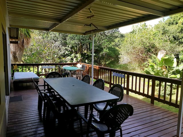 Our deck overlooking the beautiful Milkwood trees which are full of birdlife & private & sheltered from the wind.