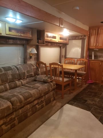 Large living area with couch that folds to small double for a comphy night sleep for 2!