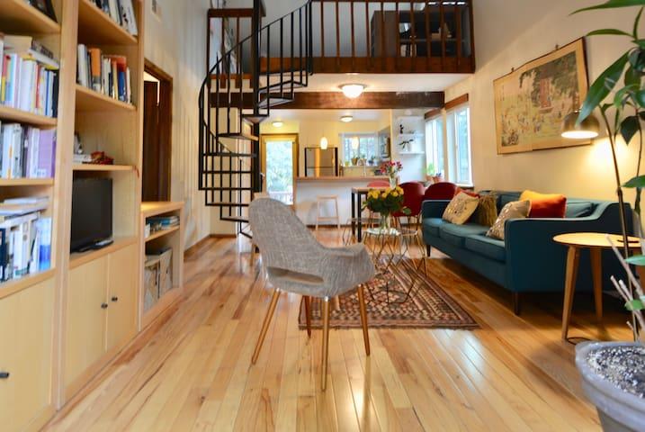 Sunlit condo with loft