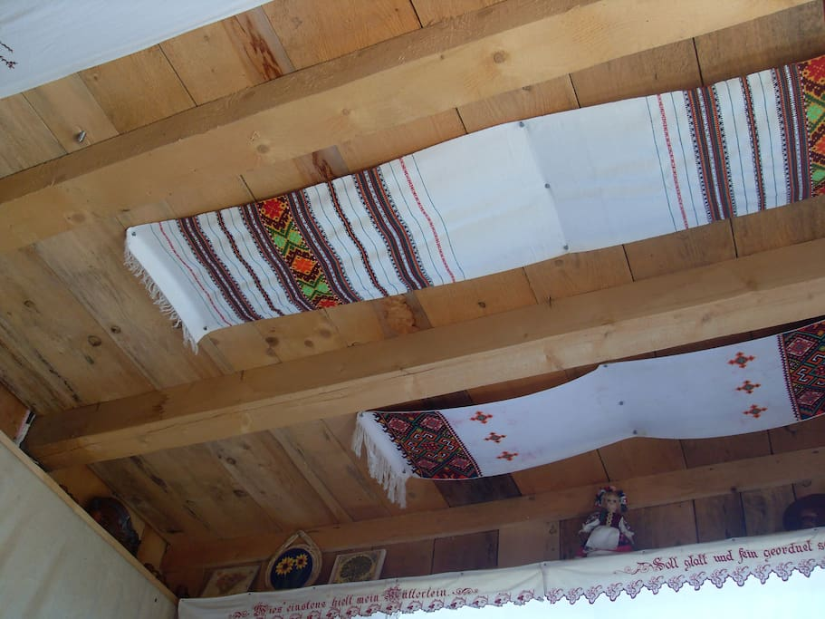 The ceiling in the rustic room