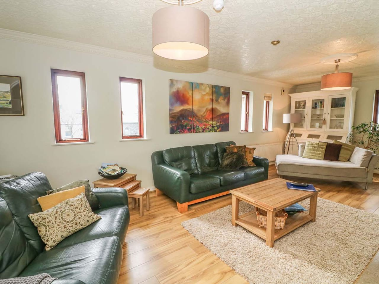 Large Comfortable Lounge seating for 7 with mountain views and glass desk with chair for laptop etc.
