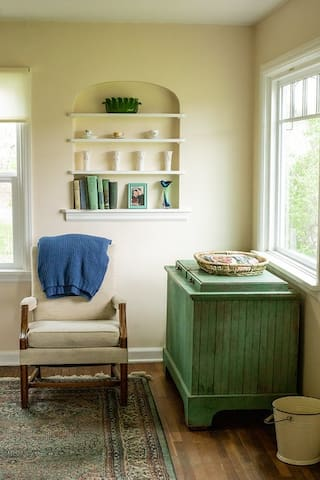 Easy chair next to our family ice box from the early 1900s. (Photo credit Arlie Sommer)