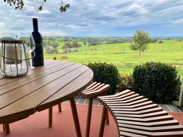 Let your mind wonder over the captivating views of Heathcote region from the verandah
