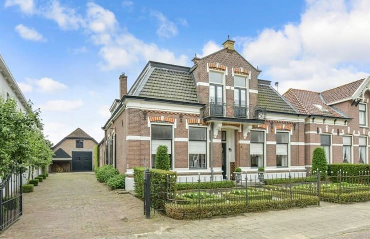 Double bed in old farmhouse in city center Nijkerk