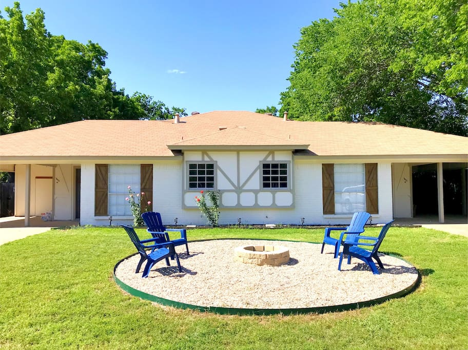 Front of Duplex with fire pit to enjoy nature and relax