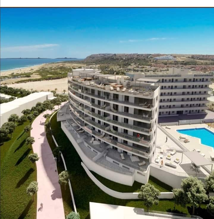 Beach apartment, sea views, large terrace & pools