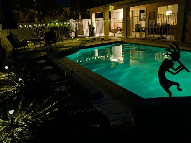 outdoor lighting and pool lights making for a nice atmosphere