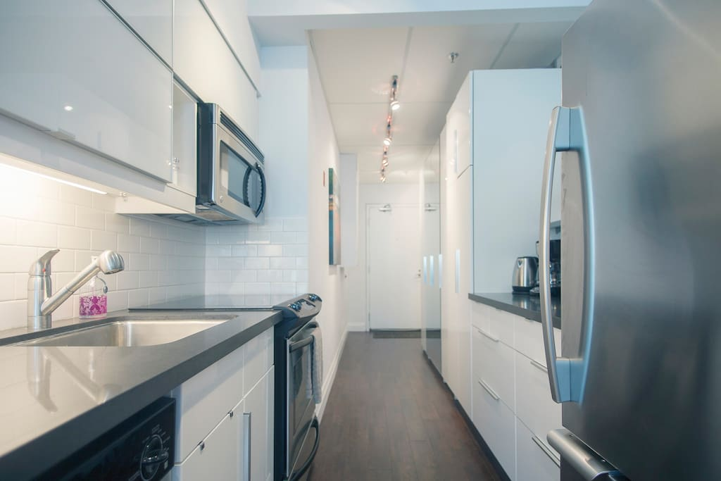 Walk in the front door to a beautiful kitchen with stainless steel appliances