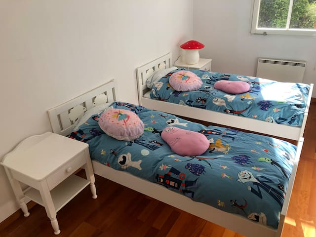 Childrens' bedroom down stairs with two 170cm long beds.