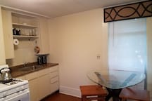 Kitchen, gas stove, refrigerator, seating area