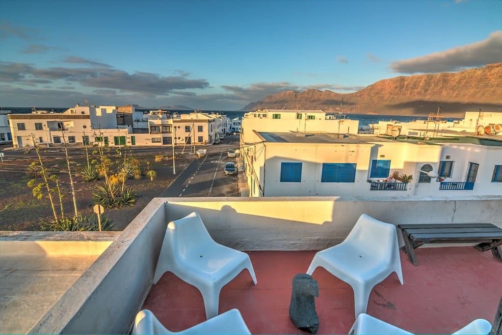 Huge roof terrace with the view to the moutains, volcanos and the ocean