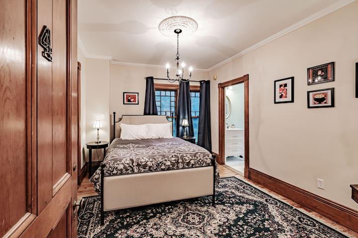 Bedroom #4 with one queen bed and en suite bathroom.