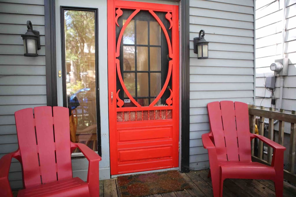 Bright red entrance door - you can't miss us!
