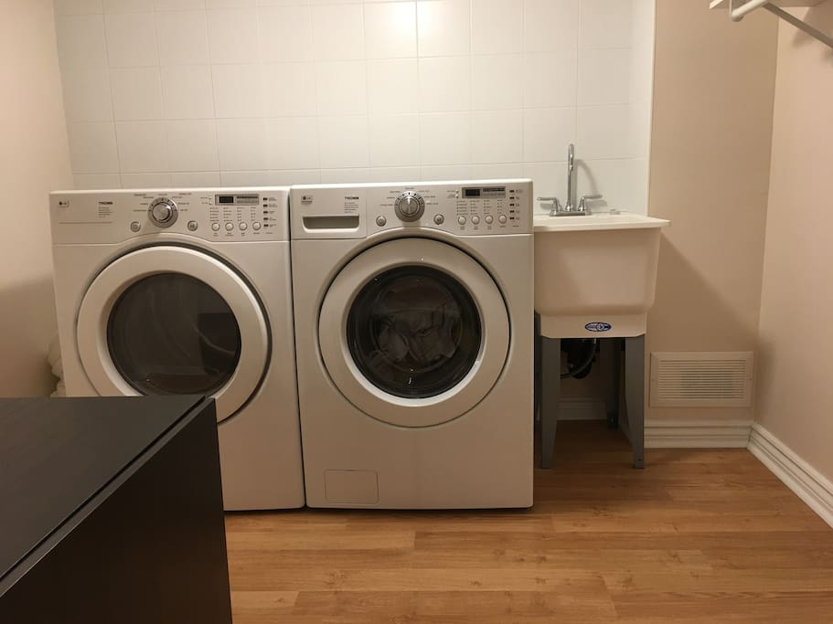 Fully stocked washer and dryer, as well as laundry sink