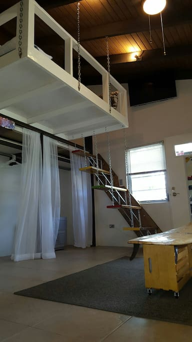 Floating staircase leads you to a large open king size bed loft with view of large  40 inch flat screen smart TV