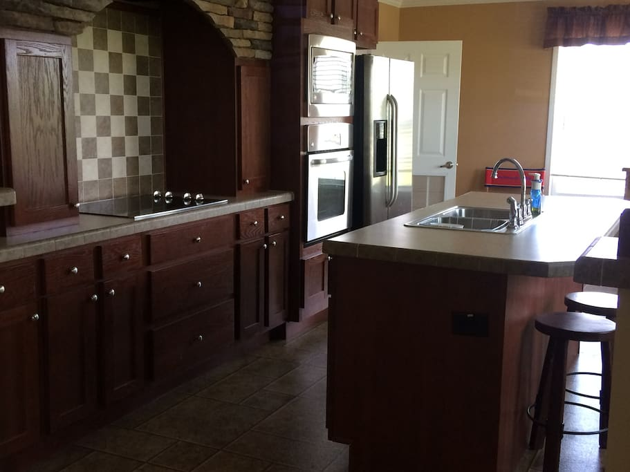 Stove top, oven, microwave, coffee maker, toaster oven.  Spotless!