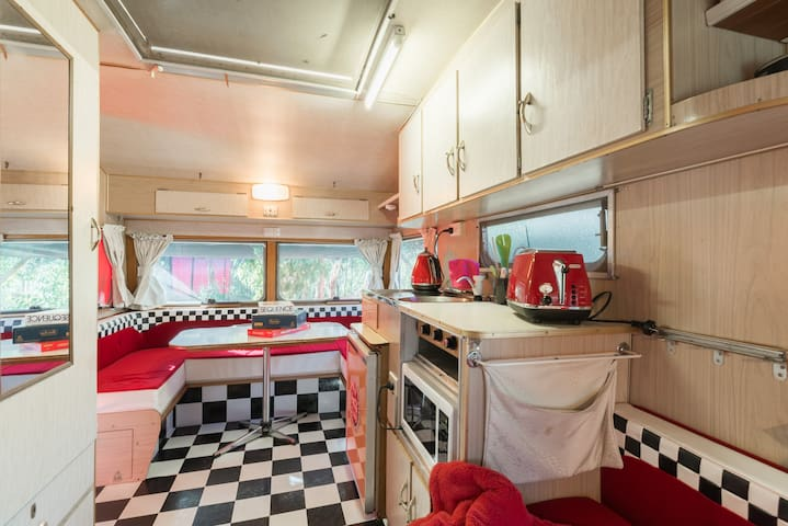 The kitchen has a gas cook top, microwave and small fridge.