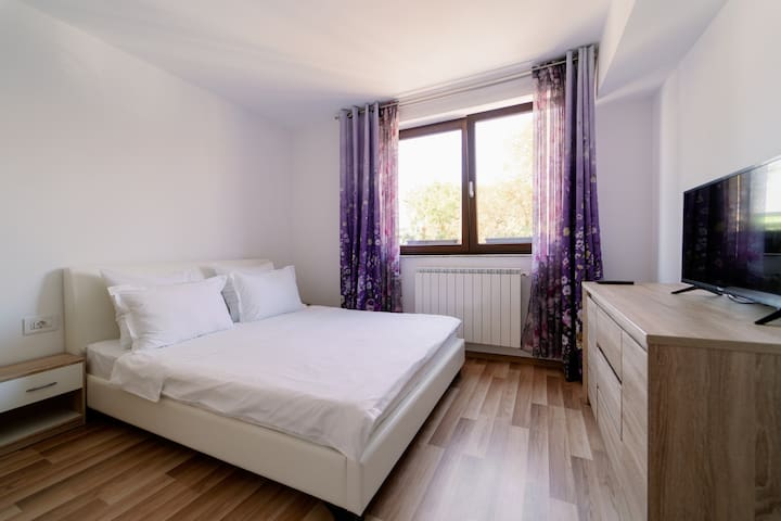 Cozy and intimate bedroom with large double bed