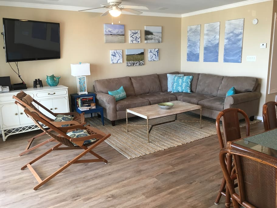 The living room looks right out to the beach.  The chairs on the left can face the beach or the living room.