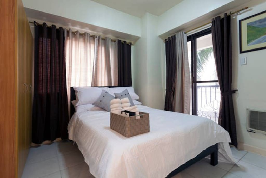 Bedroom with Full bed, aircon and balcony