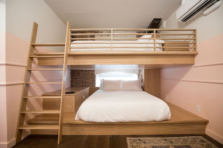 Spacious custom made Queen bunk beds with built in outlets!