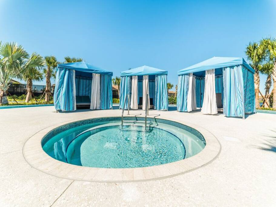 Pool area with cabanas