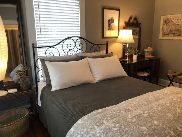 Beautiful bedroom with a comfy and inviting queen size bed to rest, nap or get a good nights sleep.