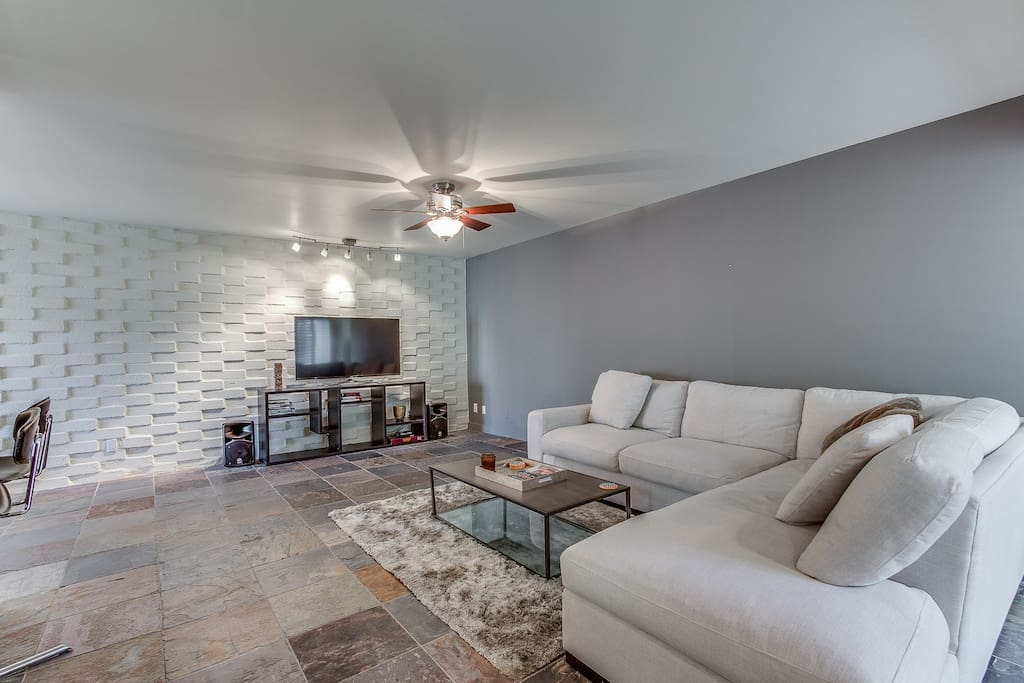 Spacious living room with TV &  entertainment center
