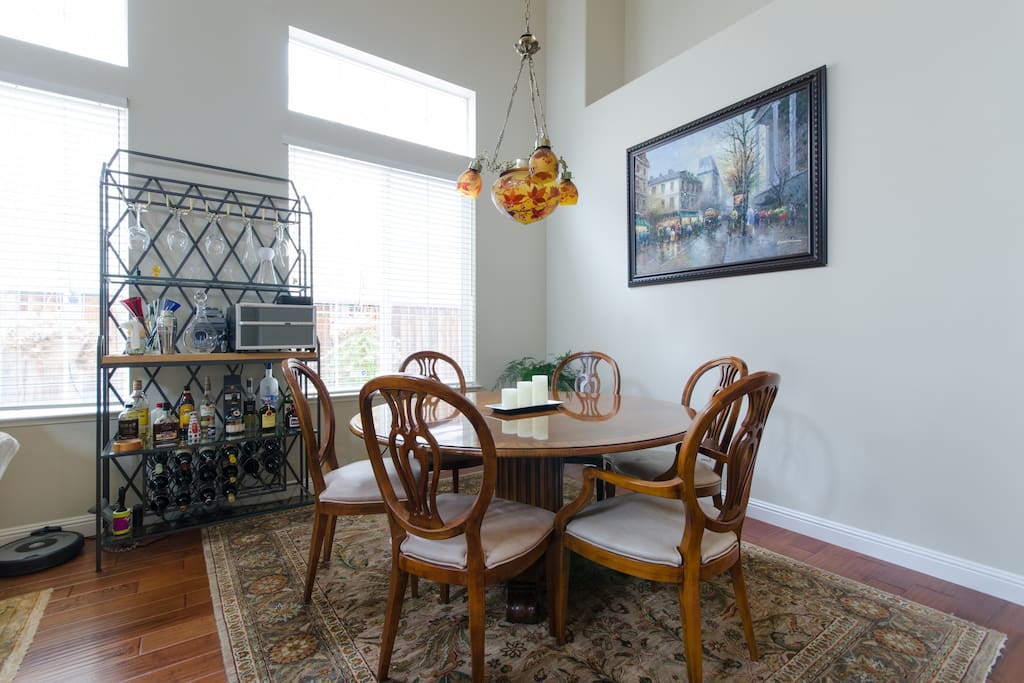 High ceiling formal dining area.