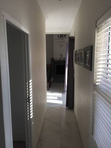 Passage leading from bedrooms to living area